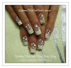 Wedding Nails... French with bling bling bling.  Looks like the Big Fat American Gypsy Wedding style.