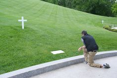 Grave Of Edward Ted Kennedy in Arlington National Cemetery, not far from his brothers Robert and John. (That is not a family member, just a tourist.)