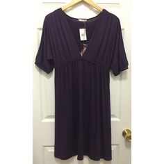 NWT Soprano Knit Dolman Sleeve Dress in Eggplant Knit dress is rich eggplant from Soprano. New with tags. V-neck. Short dolman sleeves. Elastic under bust. Dress up for going out or would also make the perfect beach cover-up. 60% polyester. 32% rayon. 8% Lycra. Size Medium. Soprano Dresses Midi