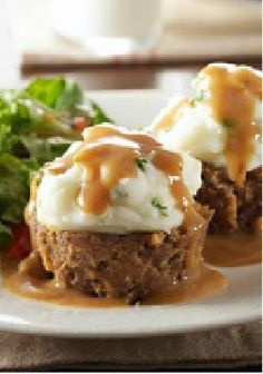 "Potato-Topped Mini Meatloaves -- Meatloaf, mashed potatoes and gravy in a savory dish that looks like a cupcake? It's going to be hard to ""top"" this delicious recipe."