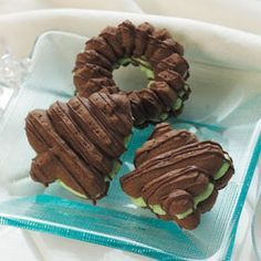 Filled Chocolate Spritz Recipe -I like how the creamy mint filling peeks through between the layers of these sandwich cookies. A chocolate drizzle on top is a flavorful finishing touch.
