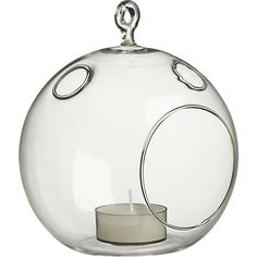 CB2 Glass Globe Hanging Candle Holder ($4.95) -- hang from fishing line to make them appear like they're floating!