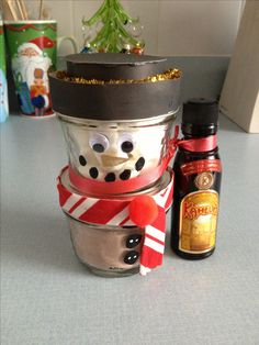 DIY hot chocolate snowman:    Great gift for co-workers!!    Mason jars from Save On Foods (12 pack)  Marshmallows on the top one, hot chocolate on the bottom one. Glue gunned them together and tied a mini liquor bottle that I had in my cupboard. Got the paint pens, cardboard, eyes and other decorations from Micheal's and Dollarama. Diy Christmas Gifts For Coworkers, Christmas Crafts, Christmas Foods, Xmas Gifts, Mason Jar Gifts, Mason Jars, Mini Liquor Bottles, Christmas Hot Chocolate, Alcohol Gifts