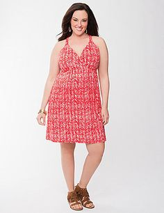 Detailed with braided straps and the season's must-try tribal print, this soft knit dress has serious fashion cred. The sexy cut was made for curves, flaunting your shape with a surplice neckline, racer back and the perfect length for fun in the sun.  Elastic seamed waist gives it great shape alone or paired with your favorite belts. lanebryant.com