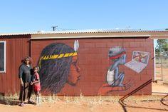 In June 2013 street artist Seth aka Globepainter aka Julien Malland came to Ikuntji Artists. Julien worked with Ikuntji artist Alison Napurrula Multa to create a fantastic mural at the Art Centre featuring a portrait of Alison and her grandson.