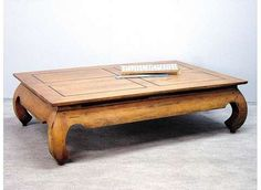 Teak Opium coffee table. Always wanted one of those. Imagine it on a nice fluffy rug, with a shitload of pillows around it (no couch, that would look awful). ~ $260