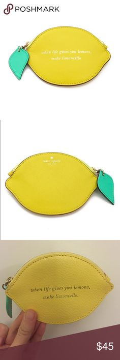 Kate Spade Lemon Coin Purse A lemon-shaped Kate Spade New York pouch with 'When life gives you lemons, make limoncello' lettering is a clever way to carry the necessities. Zip closure and lined interior.  Leather. Worn once.  MEASUREMENTS Height: 3.5in / 9cm Length: 5in / 12.5cm kate spade Bags Wallets