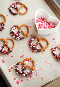 Pink party pretzels! Dip one side of pretzel in dark or white melted candy coating, add sprinkles