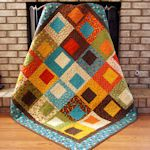 I made a quilt almost identical to this.  It was really easy and turned out so cute.