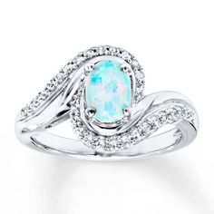 An iridescent lab-created opal is embraced by sweeps of sterling silver arrayed with lab-created white sapphires in this beautiful ring for her. Baguette Diamond Rings, Diamond Cluster Ring, Engagement Ring Settings, Diamond Engagement Rings, Morganite Ring, Rings For Her, Opal Rings, Unique Rings, White Gold Diamonds
