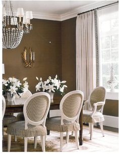Chocolate walls, skirted chairs
