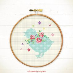 Easter cross stitch pattern - Chick with Floral Wreaths  Chick shadow with a lovely floral wreaths. A great idea for spring and easter cross