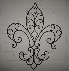 My Kitchen- I have this. Pretty!   Metal Fleur de lis Wall Decor/ Wall Hanging / Shabby Chic / Black Wrought Iron. $34.00, via Etsy.