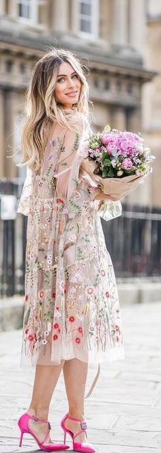 blushly smiling blonde in sheer creamy maxi dress w/ floral embroidery, pink lava d'Orsays w/ pink bouquet