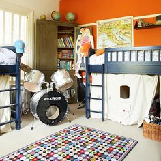 ORANGE:  Just One Wall  If you're hesitant to paint an entire room in a bold shade, opt for using the saturated shade on just one wall. This kid-approved orange gives this boys' bedroom a hint of fun and contrasts nicely with the navy blue lofted bed.