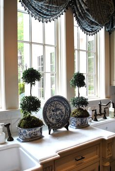 Blue, white, and topiaries