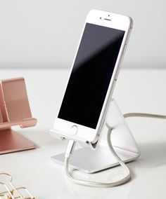 This metallic phone stand fits both phones and tablets and is a stylish way to keep your desk organized. The stand holds your phone/tablet horizontally or vertically. Details Fits up to 7 inch phone and tablets Aluminum Imported