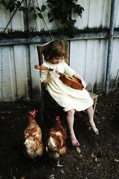 And this girl played a song for the chickens.