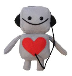 """If you like the bigger one, then you'll love his little knock-off. This super cute 6"""" tall completely hand sewn robot is made of gray felt, black fleece, 100% polyfiber fill, yarn, embroidered black mouth and safety eyes.Available in pink, baby blue and gray"""