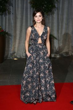 Pin for Later: A Look Back at Jenna Coleman's Rise to Stylish Stardom  A glamorous printed Rochas gown with a cutout was a surprise choice for the 2015 BAFTA Awards.