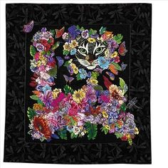 39' x 39', 2005Priscilla Kibbee's world travels have taken her to exotic places such as Turkey and Nepal, where she teaches quilting to children and adults. Priscilla appliqud this embroidered cat and surrounded it with a garden of fused flowers. The entire quilt was then machine appliqud with invisible thread and embellished with machine and hand beading and crystals.Designer Contact:Priscilla Kibbeepkibbee@aol.compriscillakibbee.citymax.com