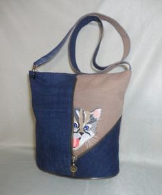 Embroidered bag with kitty design - abigail Jean Purses, Purses And Bags, Denim Purse, Denim Ideas, Denim Crafts, Recycle Jeans, Embroidered Bag, Patchwork Bags, Free Machine Embroidery Designs