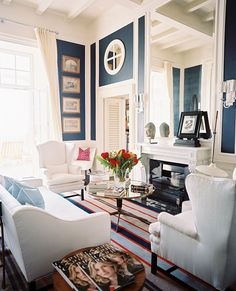 navy paint + white trim - rich color kept light and airy in a small room.