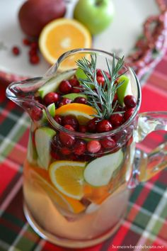 Making Spirits Bright: Christmas Sangria with Rosemary Simple Syrup! As easy to mix as it is to drink! | Home is Where the Boat Is #cocktail
