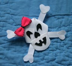 Skeleton, Skull, Crossbones Ribbon Sculpture Hair Clip. $5.75, via Etsy.