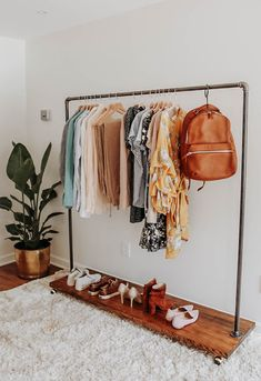 """A Guide to Building a Capsule Wardrobe is part of Clothing rack bedroom It is so easy to get stuck in a cycle of purchasing what we think we """"need"""" or impulse buy if we feel it is something tha - Apartment Closet Organization, Diy Apartment Decor, Bedroom Apartment, Organization Ideas, Men Apartment, Clothing Organization, Closet Bedroom, Clothes Rack Bedroom, Closet Dresser"""