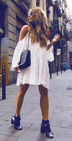 Angelica Blick is wearing a white dress from BikBok and bag and shoes from Zara