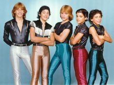Tight and shiny 80s fashion.  By the way, I'm pretty sure this is Manudo! and that's Ralph Macchio in the red pants.