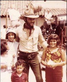 """Sanid Miller: """"Elvis on the LA set of """"Charro"""" with the {aiva family. The kids were were not in the movie. Their dad was a huge Elvis fan and would take the whole family up to his homes and sometimes on location. There's photos of them at the Hillcrest house also."""""""