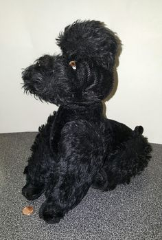 Old poodle - stuffed with movable parts