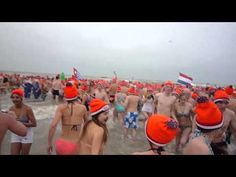 Every year, thousands of red 'Unox' hats are given away along with hot dogs and pea soup when the Dutch celebrate the new year by diving into the ice-cold North Sea waters en masse.