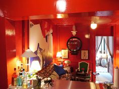 Nick Olsen  #NYC #apartment #Manhattan: love the hot orange for my library