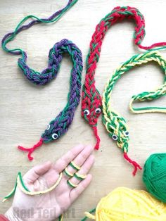 """Finger Knitting Snakes - these snakes are so cool and fun to make. Learn about finger knitting with two colours of yarn, as well as our new technique of """"increasing"""" and """"decreasing"""" a stitch. So fun and easy!! #fingerknitting #projects #snakes"""