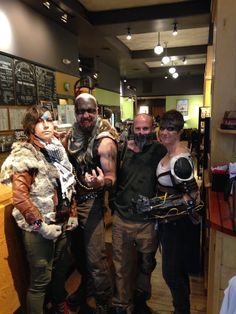 Mad Max and Furiosa grabbing a latte with friends, post-apocalypse Halloween