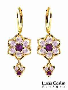 Lucia Costin Dangle Flower Earrings Made of 24K Yellow Gold Plated over .925 Sterling Silver with Violet and Lilac Swarovski Crystal Flowers Surrounded by Twisted Lines, Enhanced with Lovely Charms Lucia Costin. $57.00. Floral earrings amazingly designed by Lucia Costin. Amazingly designed with purple and light purple Swarovski crystals. Update your everyday style with inspiration when wearing this piece of jewelry. Unique jewelry handmade in USA. Dangle ornaments accente...