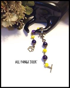 LSU Bracelet that is part of a set handcrafted by AllThingsJolie78 on Etsy - GEAUX TIGERS