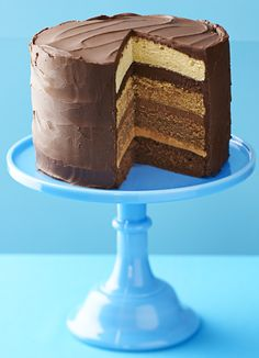 Triple chocolate caramel cake. This chocolate caramel cake is what's known as an 'ombre' cake; each layer has a different shade with dark chocolate, milk chocolate and caramel flavours.