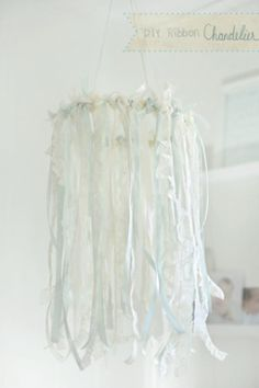 It is a simple lace and ribbon mobile that would dress up any nursery. I LOVE IT! Make one with the shades of blue and tan and hints of coral if it's a girlie