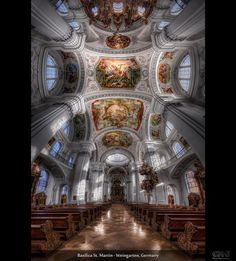 Basilica St. Martin – Weingarten, Germany (HDR Vertorama)    This HDR vertorama was taken in the Basilica St. Martin in Weingarten, Germany. This wonderful church was built between 1715 and 1724. The white interior creates a fantastic light, and when the sun is shining, this place lights up. This is a classical example of a scene that requires HDR. In a normal shot, you could never capture how the sun shines on those pillars without the rest of the shot being hopelessly underexposed.