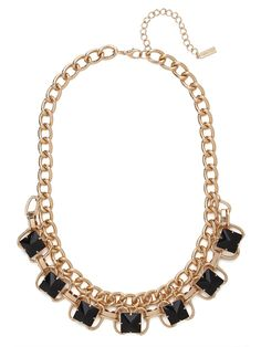 Obelisk shaped onyx gems and a meshwork of golden chains make this collar the ultimate in downtown style.
