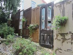 Unique privacy fence made with antique doors