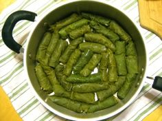 Dolmas (Stuffed grape leaves, with mint, lemon, and pine nuts)