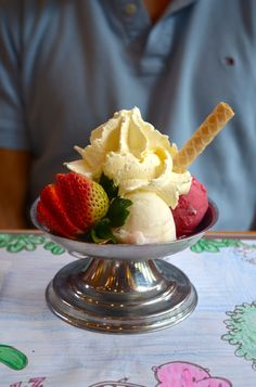 Hawaii ice-cream. Scoops of guanabana , mango and mora (raspberry) with whipped cream and topped of with a strawberry.