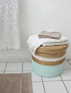 i have at least one million functional but ugly baskets in storage in nyc. what a smashing way to give new life...
