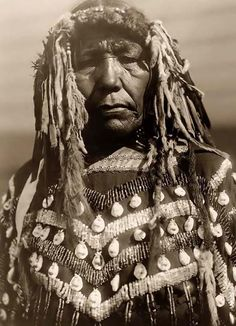 Here for your consideration is a pleasing picture of a Piegan Indian Woman. It was created in 1910 by Edward S. Curtis.    The photograph presents Piegan woman, half-length portrait, facing front.    We have created this collection of illustrations primarily to serve as a valuable educational tool. Contact mailto:curator@ol....