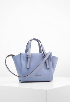"Handbag - cashmere blue. carrying handle:4.0 "" (Size One Size). Fastening:Zip. height:6.5 "" (Size One Size). Fabric:Synthetic leather. Outer material:faux leather. width:3.0 "" (Size One Size). length:10.0 "" (Size One Size)..."